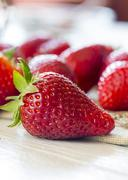 Stock Photo of Strawberries on cloth and wooden table