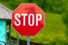 Stop sign closeup photo with nature in background - stock photo