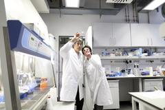 Germany, Freiburg, Scientists in laboratory discussing experiment Stock Photos