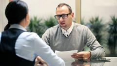 Businesswoman talking with businessman during job interview HD - stock footage