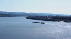 Self propelled barge sailing upstream - stock footage