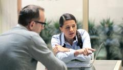 Businesswoman explaining something to male client in the office HD Stock Footage