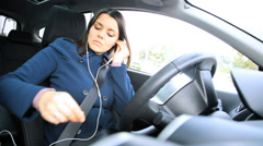 Gorgeous woman starting to drive car making phone call - stock footage