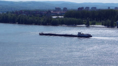 Self propelled barge sailing upstream river Danube Stock Footage