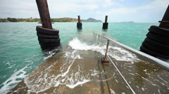 Thailand. Phuket Island. Surf the waves on pier Stock Footage