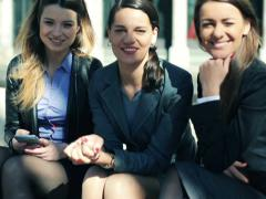 Happy group of young business women sitting in the city NTSC Stock Footage