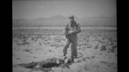 Soldiers with Geiger Counter walking around destroyed sandbag emplacement Stock Footage