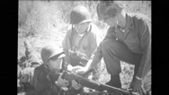 Military soldier showing others two soldiers to use machine gun Stock Footage