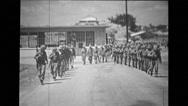 Troop of soldiers walking in a row Stock Footage