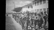 Troop of soldiers marching on road Stock Footage