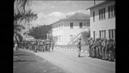 Troop of soldiers marching while other troops watching them Stock Footage