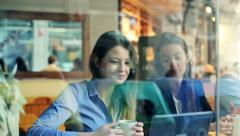 Young attractive businesswomen talking during coffee break in cafe HD Stock Footage