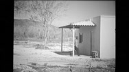 Soldier entering a small built structure at Cuban border Stock Footage