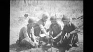 Military soldier showing others three soldiers to use machine gun Stock Footage
