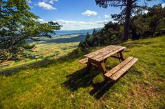 Wooden bench without people - stock photo