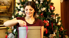 Pretty girl disappointed for a gift. HD - stock footage