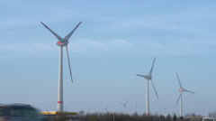 Large windmill off German highway spinning Stock Footage