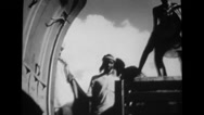 Workers loading supplies of ammunition and clothing into military aeroplane Stock Footage