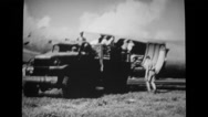 Military truck loaded with supplies from US Navy moving away Stock Footage