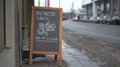 Business lunch sign at European restaurant Stock Footage