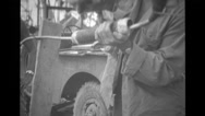 Soldier treating cable equipment Stock Footage