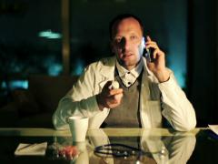 Doctor explain how to use drugs to patien over the phone at night NTSC Stock Footage