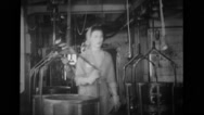 Female workers working in manufacturing plant Stock Footage