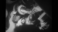 Female worker moving container filled with pellets in manufacturing plant Stock Footage