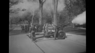 Military soldiers firing cannons Stock Footage