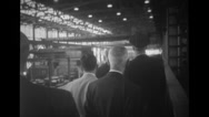 Officers walking inside the automotive factory Stock Footage