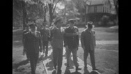 Military officers walking in military base Stock Footage