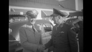 Officers shaking hands while at airport Stock Footage