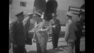 Officers shaking hands beside military aeroplane at airport Stock Footage