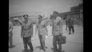 Officers saluting and shaking hands at airport Stock Footage