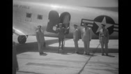 Officers boarding military aeroplane at airport Stock Footage