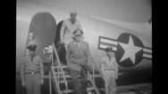 Officers coming out of military aeroplane Stock Footage