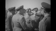 Military officers shaking hands and saluting at the airport Stock Footage