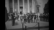 Military officers and honour guards marching towards the building Stock Footage