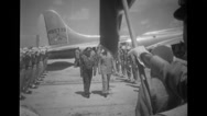 Military officers saluting while soldiers welcoming them at airport Stock Footage