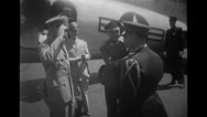 Military officers greeting and shaking hands by military aeroplane Stock Footage