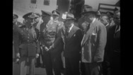 Military officers standing and talking in front of aeroplane Stock Footage