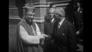 Priests shaking hands with officer Stock Footage