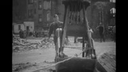 Military soldier walking along debris of bombed-out building Stock Footage