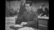 Letters being stamped at a counter Stock Footage