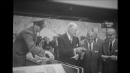 Mr. John Folger, Gen Howard Cullman and Mr. Struyf attending the inauguration Stock Footage