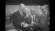 Man showing stamp album to honorable guests Stock Footage