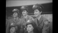 Women dressed in letter carrier uniforms at Brussels World's Fair Stock Footage