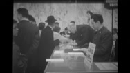 Visitors getting envelopes stamped at Brussels World's Fair Stock Footage