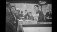 Visitors at information center at Brussels World's Fair Stock Footage
