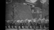 Soldiers bowing in front of the temple gate Stock Footage